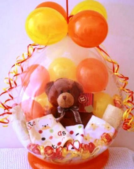Детский шар с одеждой (3 предмета) и игрушкой